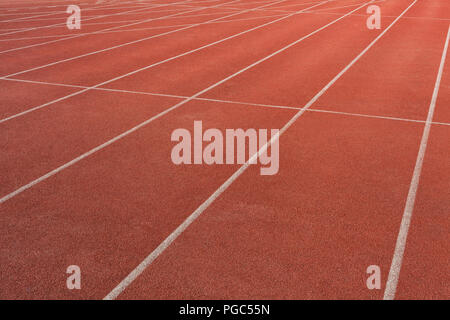 Numbers on the track is the finish pointred running track on athletic stadium background texture - Stock Photo