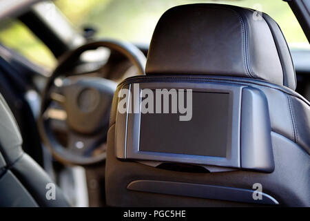 Car inside. Interior of prestige luxury modern car. Display for back seats passenger with copy space mock up.