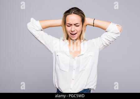 Young beauty woman screaming over gray background - Stock Photo