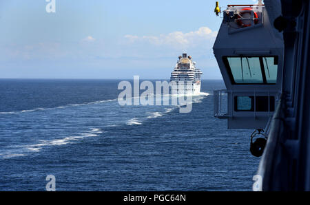 Cruise ship Coral Princess seen from MS Volendam while cruising Alaska's Inside Passage - Stock Photo
