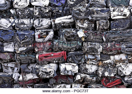Demolished car wrecks piled in scrapyard, Tenerife Canary Islands Spain. - Stock Photo