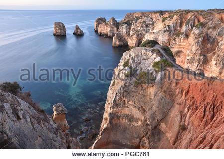 Ponta da Piedade, sandstone cliffs in morning light. Atlantic coast near Lagos Algarve region southern Portugal Europe. - Stock Photo