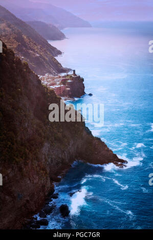 Vernazza justs into the Mediterranean Sea along the Cinque Terre coastline in, Italy. - Stock Photo