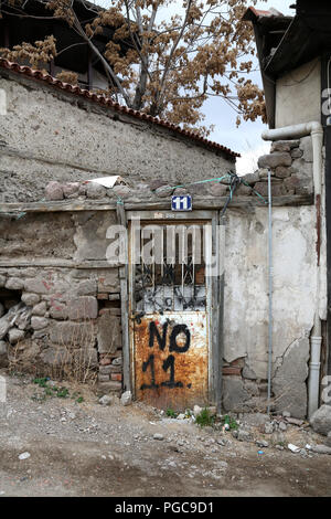 Door in Ankara, Turkey, with number 11 written on it - Stock Photo