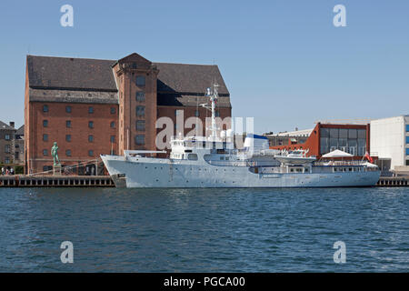 British yacht Capella C moored at Toldbodgade at sculpture David and art gallery Royal Cast Collection in the old West Indian warehouse in Copenhagen - Stock Photo