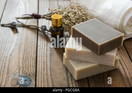 Handmade natural soap on wooden background - Stock Photo