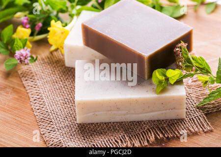 Beautiful spa setting with handmade soap - Stock Photo