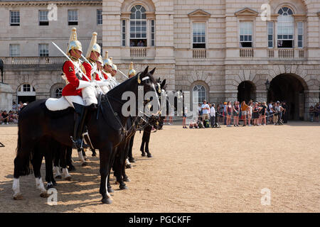 London / UK - July 26th 2018: Soldiers, mounted on horseback, on guard at Horseguard's Parade in London - Stock Photo