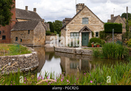 Lower Slaughter, UK - 9th August 2018: This quaint village sits beside the little Eye stream and is known for its unspoilt limestone cottages in the t - Stock Photo