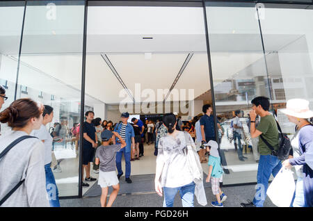 Shoppers enter the Kyoto Apple Store on the first day of business on 25th August, 2018. - Stock Photo