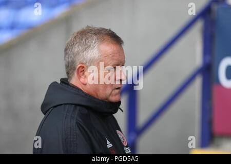 Bolton, Lancashire, UK. 25th August, 2018. Sheffield United Manager Chris Wilder in the dugout ahead of the EFL Championship game Bolton Wanderers v Sheffield United. Credit: Simon Newbury/Alamy Live News - Stock Photo