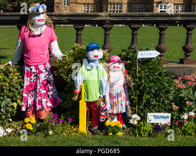 Marske North Yorkshire August 25th/ Like many Yorkshire villages Marske by the Sea has a weeklong Scarecrow Festival which started today 25th August,  many different organisations and social groups have made scarecrows an erected them around the village.  Parents and children can get a trail map to follow and view all the exhibits.  There is a prize draw at the end of the week.  Mothers Union Display of a mother anD children going to the beach Credit: Peter Jordan NE/Alamy Live News - Stock Photo
