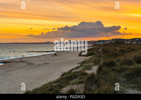 Southbourne, Bournemouth, Dorset, UK.  25th August 2018. UK Weather.  A dramatic orange sunset over Bournemouth viewed from Southbourne beach in Dorset at the end of a warm sunny day during the bank holiday weekend.  Picture Credit: Graham Hunt/Alamy Live News - Stock Photo