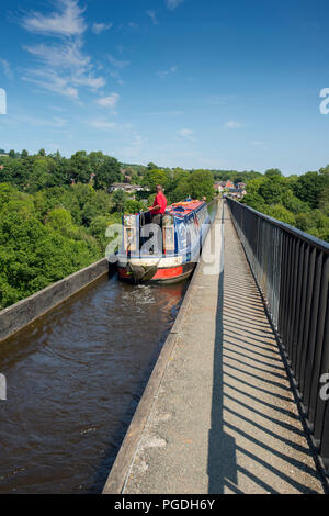 Narrow boat on the Pontcysyllte Aqueduct, which carries the Llangollen Canal across the River Dee in north east Wales in the UK - Stock Photo
