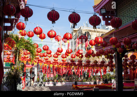 Red Chinese lanterns with chinese characters for fortune, happiness and luck. Chinese new year celebration in temple - Stock Photo