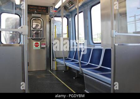 CTA Yellow Line Skokie Swift commuter train interior of the 5000 series. - Stock Photo