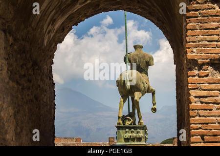 Pompei, near Naples, Italy - June 1, 2018 - Statue 'Centauro' by modern Polish artist Igor Mitoraj, overlooking ruins of Pompei - Stock Photo