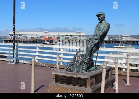 The Fisherman by Artist Jesse Corsaut on Old Fisherman's Wharf, Monterey, California, USA - Stock Photo