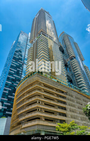 Singapore  - August 11, 2018: Blue and Golden tall buildings with blue sky - Stock Photo