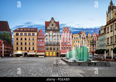 Rynek square with old colorful houses and fountain in Wroclaw, Poland - Stock Photo