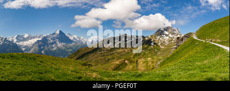 Walking country in Grindelwald-First in the Jungfrau region of the Bernese Oberland Alps, Switzerland with view of the Eiger mountain - Stock Photo