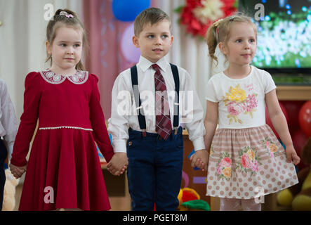 Belarus, Gomel, May 24 2018. The kindergarten is central. Open Day.Three smart children on the matinee - Stock Photo