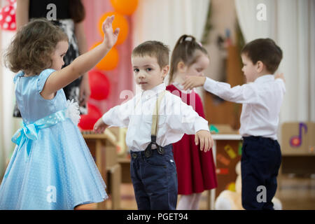 Belarus, Gomel, May 24 2018. The kindergarten is central. Open Day.Little girl and boy dancing on the matinee - Stock Photo