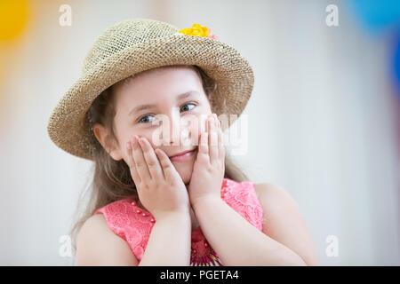 Belarus, Gomel, May 24 2018. The kindergarten is central. Open Day.Beautiful preschool girl in a hat admires - Stock Photo