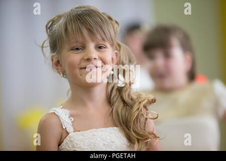 Belarus, Gomel, May 24 2018. The kindergarten is central. Open Day.Beautiful joyful six seven cheerfully smiling - Stock Photo