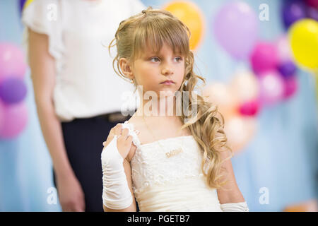 Belarus, Gomel, May 24 2018. The kindergarten is central. Open Day.Sad child on holiday - Stock Photo