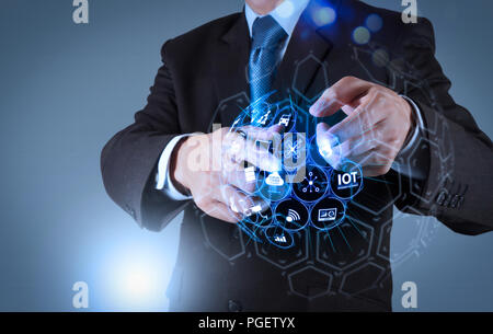 Internet of Things (IOT) technology with AR (Augmented Reality) on VR dashboard.Businessman hand pressing an imaginary button on virtual screen - Stock Photo