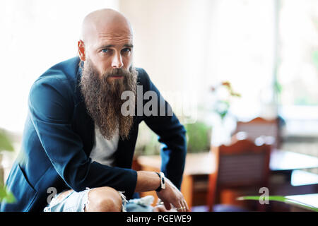 Portrait of bearded handsome confident man. Hipster lifestyle - Stock Photo