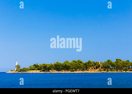 Cranae or Marathonisi island with Tzanetakis medieval tower, an island off the coast of Gytheio connected to the land by a causeway built in 1898 - Stock Photo