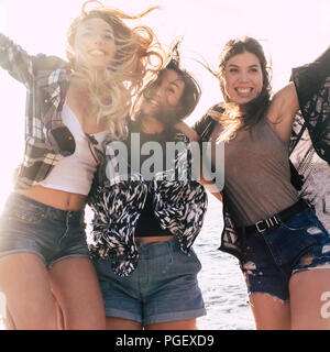 group of cheerful and happy girls jumping with happiness and enjoying friendship and youthness. outdoor leisure activity for beautiful young females h