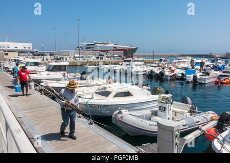 Sail boats and motorboats in Marina of Tarifa, leisure port, Ferry port behind, Costa de la Luz, Andalusia, Spain. - Stock Photo