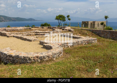 Lin, Albania- 27 June 2014: remains of a Roman villa from the 4th century on a hill in the village of Lin. Ohrid Lake in the background. - Stock Photo