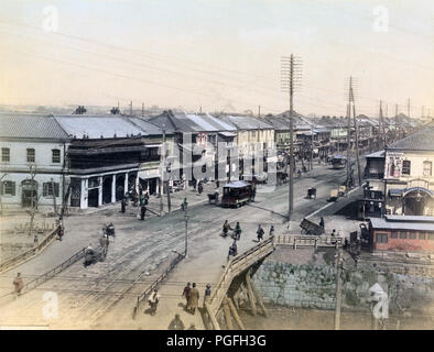 [ c. 1880s Japan - Shinbashi, Tokyo ] —   A view on the Shinbashi (also Shimbashi) bridge and Ginza avenue in Tokyo, sometime between 1882 and 1899. The wooden bridge over the Shiodomegawa (Shiodome River) was replaced with an iron bridge in April 1899.  19th century vintage albumen photograph. - Stock Photo
