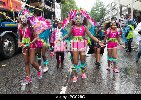 London, Britain. 26th Aug, 2018. Performers take part in the Children's Day Parade of the annual Notting Hill Carnival in London, Britain, on Aug. 26, 2018. The Notting Hill Carnival is the largest street festival in Europe and originated in the 1960s as a way for Afro-Caribbean communities to celebrate their own cultures and traditions. Credit: Ray Tang/Xinhua/Alamy Live News - Stock Photo