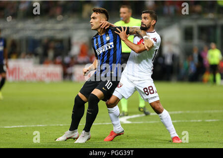 Milano, Italy. 26th August, 2018.  Lautaro Martinez of FC Internazionale and Tomas Rincon of Torino Fc in action during the Serie A match between FC Internazionale and Torino Fc. - Stock Photo