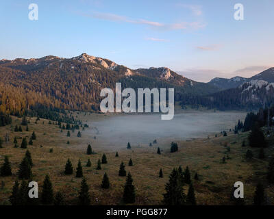 Early morning mist at Veliki Lubenovac, Northern Velebit, Croatia - Stock Photo