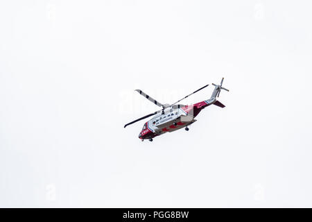 OGWEN GLEN / WALES - APRIL 29 2018 : British HM Coastguard helicopter Sikorsky S-92 operated by Bristow Helicopters conducting a rescue exercise at Og - Stock Photo