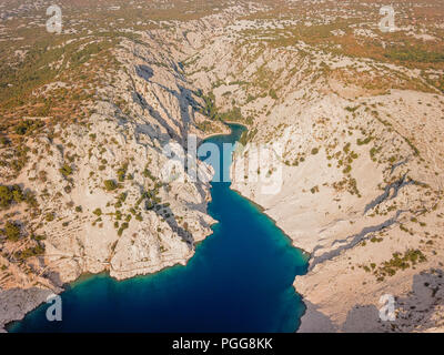 Zavratnica is a 900 m long narrow inlet located at the foot of the mighty Velebit Mountains, in the northern part of the Adriatic Sea. - Stock Photo