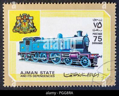 STATE AJMAN - CIRCA 1972: A stamp printed in United Arab Emirates, Shows locomotive, series, circa 1972 - Stock Photo
