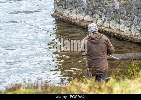 Man fishing on the beach of Llyn Ogwen, Wales - UK. - Stock Photo