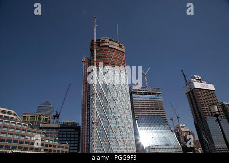 Construction of new 60 storey residential tower block Newfoundland at Canary Wharf financial district in London, England, United Kingdom. Newfoundland is a 60-storey residential building which will be situated on the western side of the Canary Wharf Estate and bound by Westferry Road to the west, Middle Dock to the east, and Bank Street to the south. The slim diamond shape of the tower is determined by the narrow footprint of the site. The dia-grid structural system expressed on the facade of the building supports and braces the structure. - Stock Photo
