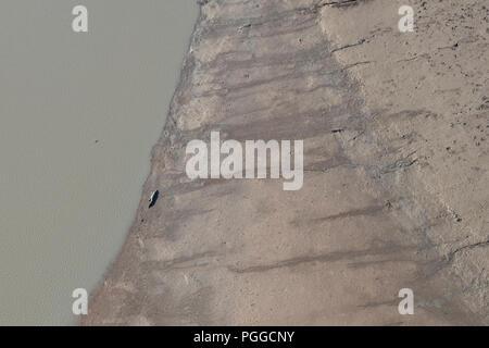 Australia, Western Australia, Kimberley, Hunter River Region, Mitchell River National Park. Aerial view of Porosus Creek mud flats at low tide. - Stock Photo