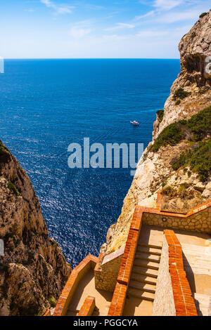 Alghero, Sardinia / Italy - 2018/08/11: Panoramic view of the Gulf of Alghero with cliffs of Cape Cappo Caccia over the Neptune's Grotto - Stock Photo