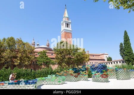 Qwalala glass wall by American artist Pae White for Biennale, Venice, Italy on San Giorgio Maggiore Island with the campanile of the church, tourists  - Stock Photo