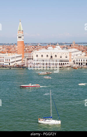Aerial view Doges Palace and St Marks Campanile, San Marco, Venice, Veneto, Italy with boat traffic in Bacino San Marco - Stock Photo