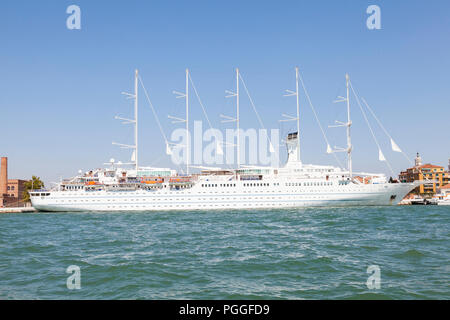 Fve-mast staysail schooner, Wind Surf, moored in Venice, Veneto, Italy. Largest passenger sailing yacht in the world, flagship of Windstar cruises - Stock Photo